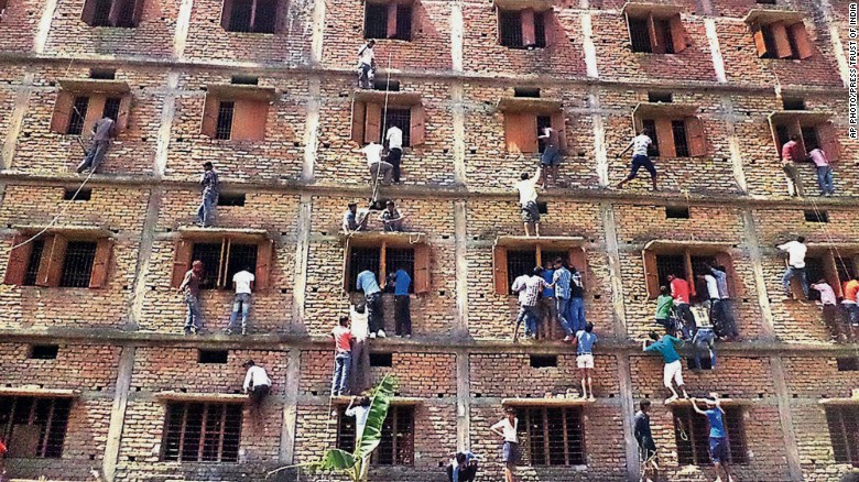 Family and friends climb buildings to help students cheat on examinations.