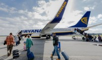 Passengers board a Ryanair flight.
