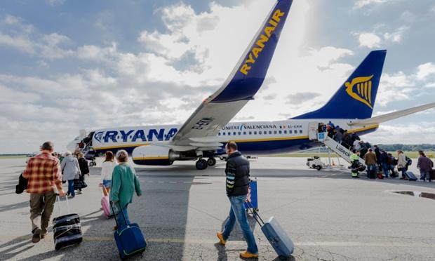 Passengers board a Ryanair flight.